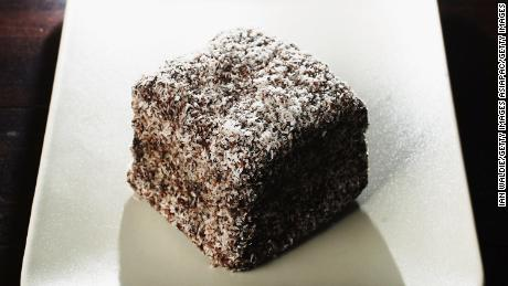 A lamington, the national cake of Australia, is a sponge cake dipped in chocolate and coated in desiccated coconut.