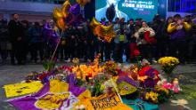 People gather to pay tribute to former NBA and Los Angeles Lakers player Kobe Bryant on January 26, 2020 following his death in a helicopter crash near Los Angeles. - Nine people were killed in the helicopter crash which claimed the life of NBA star Kobe Bryant and his 13 year old daughter, Los Angeles officials confirmed on Sunday. Los Angeles County Sheriff Alex Villanueva said eight passengers and the pilot of the aircraft died in the accident. The helicopter crashed in foggy weather in the Los Angeles suburb of Calabasas. Authorities said firefighters received a call shortly at 9:47 am about the crash, which caused a brush fire on a hillside. (Photo by Chris Delmas / AFP) (Photo by CHRIS DELMAS/AFP via Getty Images)