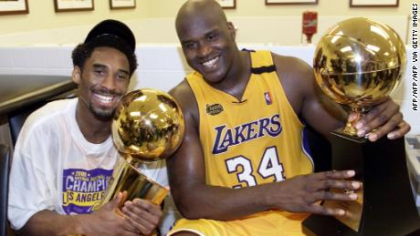 Kobe Bryant (L) celebrates with Shaquille O'Neal after winning the 2000 NBA Championship against the Indiana Pacers. The two superstars would be undone by a personality clash after their fourth trip to the finals, but became friends in retirement.