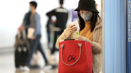 A woman refills a bottle with hand sanitizer gel while in the check-in hall at the Hong Kong International Airport in Hong Kong, China, on Wednesday, Jan. 22, 2020. China ramped up efforts to contain a new respiratory virus that killed nine people and infected hundreds, as the outbreak spread to Asias financial capital with the first reported case of the deadly illness in Hong Kong. Photographer: May James/Bloomberg via Getty Images