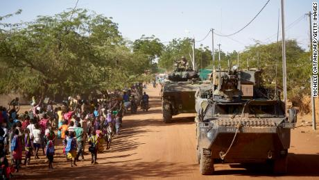 French soldiers patrol the village of Gorom Gorom in armored personnel carriers during the Barkhane operation in northern Burkina Faso on November 2019.
