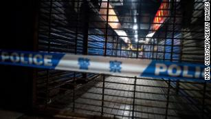 Members of staff of the Wuhan Hygiene Emergency Response Team conduct searches on the closed Huanan Seafood Wholesale Market in the city of Wuhan, in the Hubei Province, on January 11, 2020.