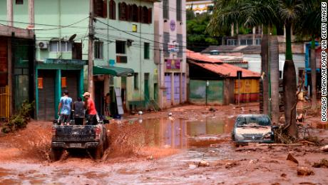 A truck rides along a flooded street after the overflowing of the Das Velhas River in Sabara, Belo Horizonte.