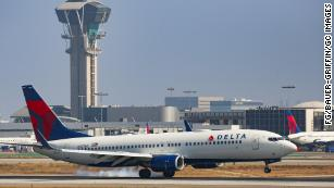 US airlines offer to change China flights for free for another month as coronavirus spreads