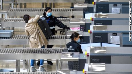 Companies restrict travel to China after outbreak