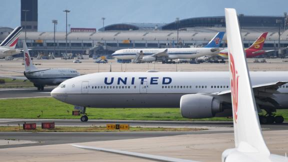 "A United Airlines Boeing 777 aircraft waits to take off at Beijing airport on July 25, 2018. - Beijing hailed ""positive steps"" as major US airlines and Hong Kong"