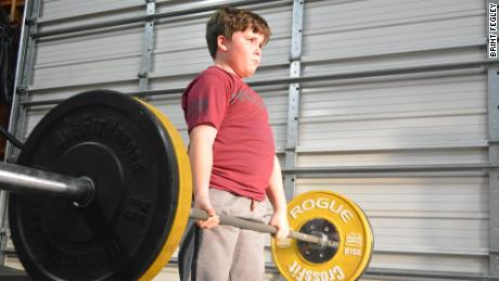A 9-year-old boy who can deadlift more than twice his bodyweight is breaking powerlifting records