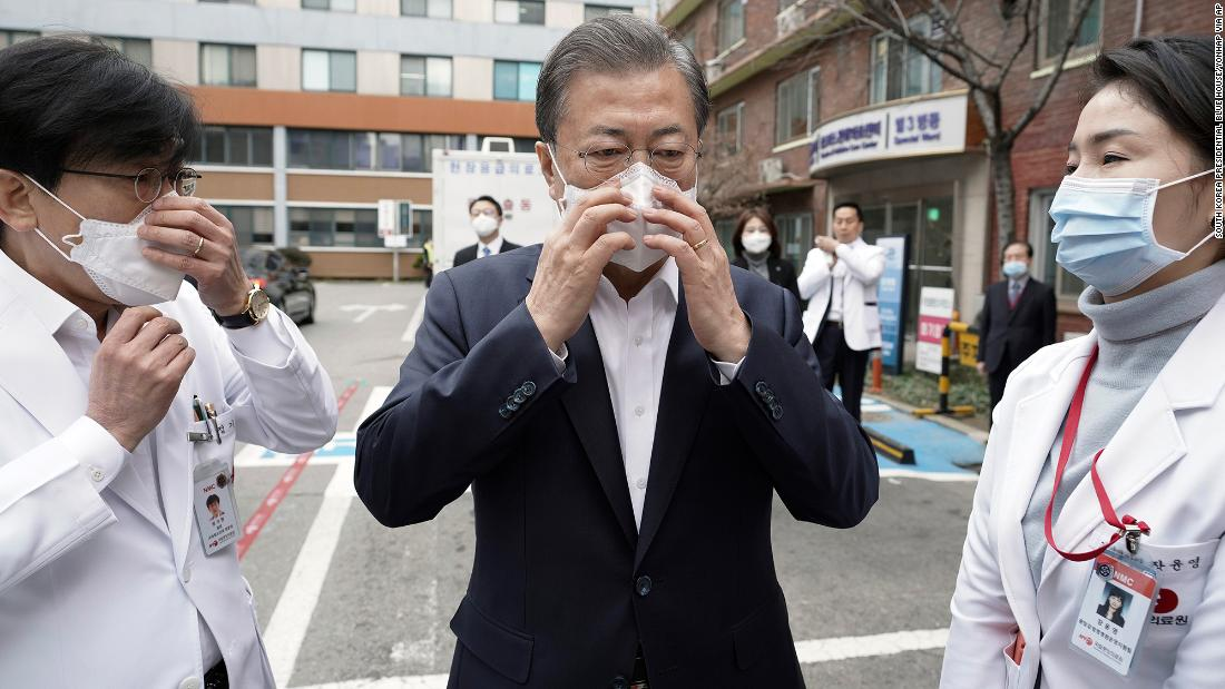 South Korean President Moon Jae-in wears a mask to inspect the National Medical Center in Seoul on January 28.