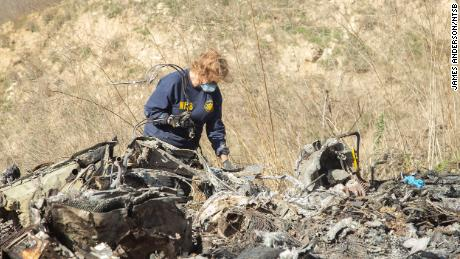 NTSB's Carol Hogan examines wreckage