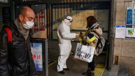 BEIJING, CHINA - JANUARY 28: A Chinese worker is dressed in a protective suit as he takes the temperature of a woman at a subway station during the Chinese New Year and Spring Festival holiday on January 28, 2020 in Beijing, China. The number of cases of a deadly new coronavirus rose to over 4000 in mainland China Tuesday as health officials locked down the city of Wuhan last week in an effort to contain the spread of the pneumonia-like disease which medicals experts have confirmed can be passed from human to human. In an unprecedented move, Chinese authorities put travel restrictions on the city which is the epicentre of the virus and neighbouring municipalities affecting tens of millions of people. The number of those who have died from the virus in China climbed to over 100 on Tuesday and cases have been reported in other countries including the United States, Canada, Australia, France, Thailand, Japan, Taiwan and South Korea. Due to concerns over the spread of the virus, the Beijing government closed many popular attractions such as the Forbidden City and sections of the Great Wall among others.(Photo by Kevin Frayer/Getty Images)