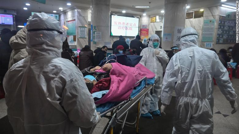 Medical staff wearing protective clothing with a patient at the Wuhan Red Cross Hospital in Wuhan.