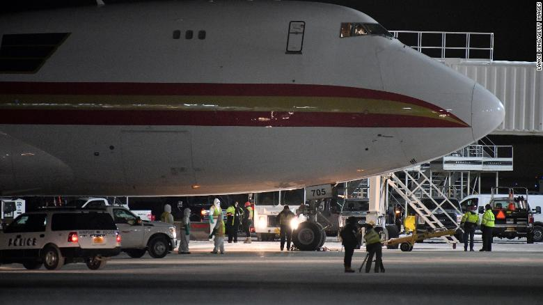 A charter flight from Wuhan arrives at an airport in Anchorage, Alaska, on January 28. The US government chartered the plane to bring home US citizens and diplomats from the American consulate in Wuhan.