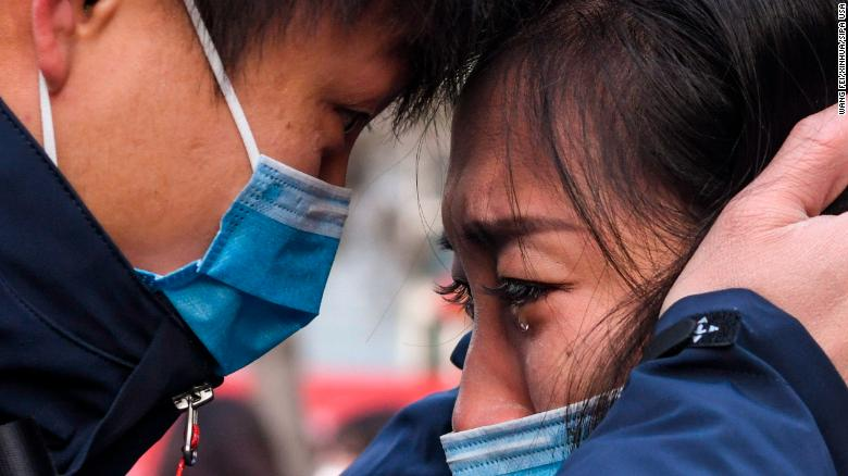 Lyu Jun, left, a member of a medical team leaving for Wuhan, says goodbye to a loved one in Urumqi, China, on Tuesday, January 28.