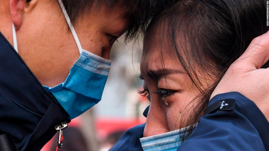 Lyu Jun, left, a member of a medical team leaving for Wuhan, says goodbye to a loved one in Urumqi, China, on January 28.