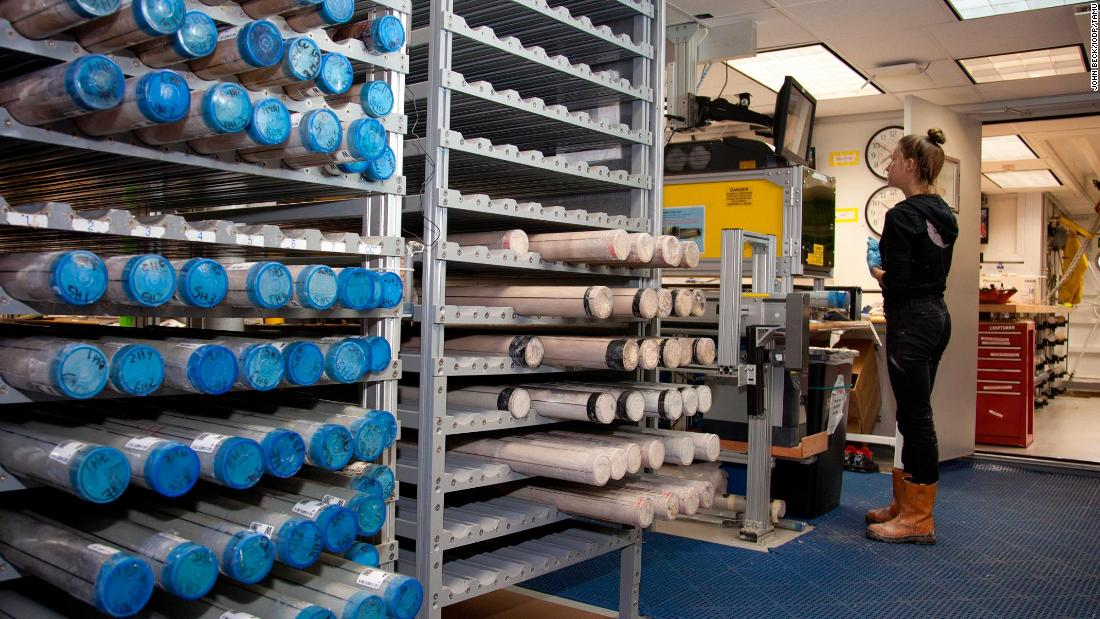 Racks of core samples aboard the Resolution in 2012. After an initial inspection, cores are split lengthways, with one half tested further. Cores are then refrigerated and stored for future scientific evaluation.