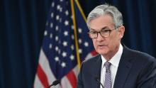 """Federal Reserve Board Chairman Jerome Powell speaks during a press conference following the January 28-29 Federal Open Market Committee meeting, in Washington, DC on January 29, 2020. - The US central bank held its policy interest rate steady on Wednesday, but again said it is monitoring """"global developments"""" to decide its next move. The Fed's policy-setting Federal Open Market Committee left the benchmark interest rate in the target range of 1.5 to 1.75 percent as expected, though it made no mention of the deadly virus outbreak in China which is feared to cause damage to the global economy. (Photo by MANDEL NGAN/AFP via Getty Images)"""