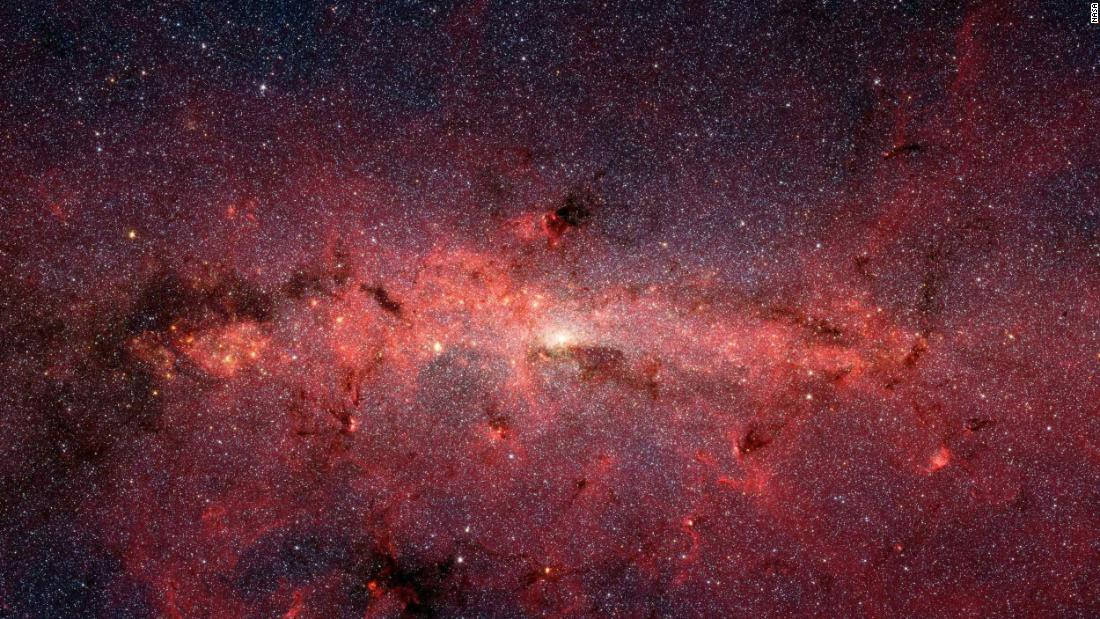 Spitzer captured hundreds of thousands of stars as they swirl at the center of the Milky Way galaxy.
