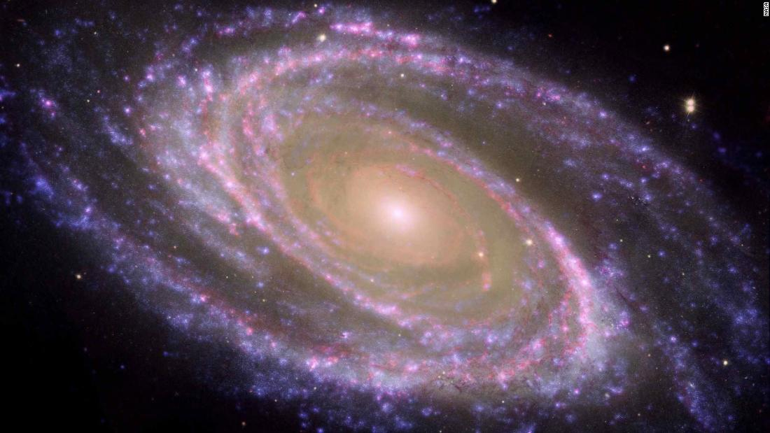 The dreamy spiral galaxy M81 is presented in crisp detail thanks to a collaboration between Spitzer, Hubble and NASA's Galaxy Evolution Explorer.