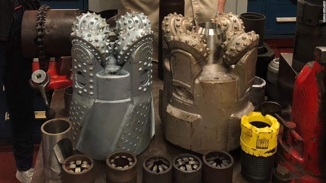 Scientists on Expedition 378 are briefed on the various drill bits used by the ship. The two larger drill bits are rotary, cutting a donut shape. Some are made of carbon steel while others are impregnated with diamonds, said Brad Clement, director of science services at the IODP.