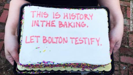 "Almost every cake had ""Let Bolton testify"" written at the bottom."