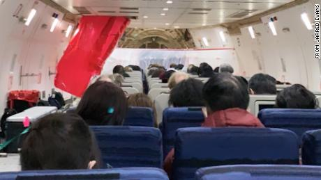 Wuhan evacuee: When the plane landed, we cheered