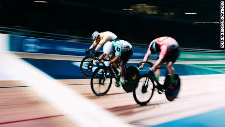 Esow Alben takes one of the sprint heats at the Berlin Six Day with a typical head down lunge for the line.