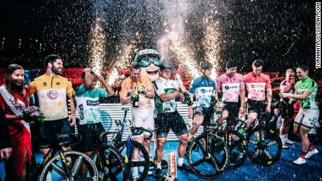 Esow (third left) and the other Berlin Six Day sprinters are sprayed with champagne by retiring former Olympic gold medallist Miriam Welte (far right) at a ceremony on the final night of competition.