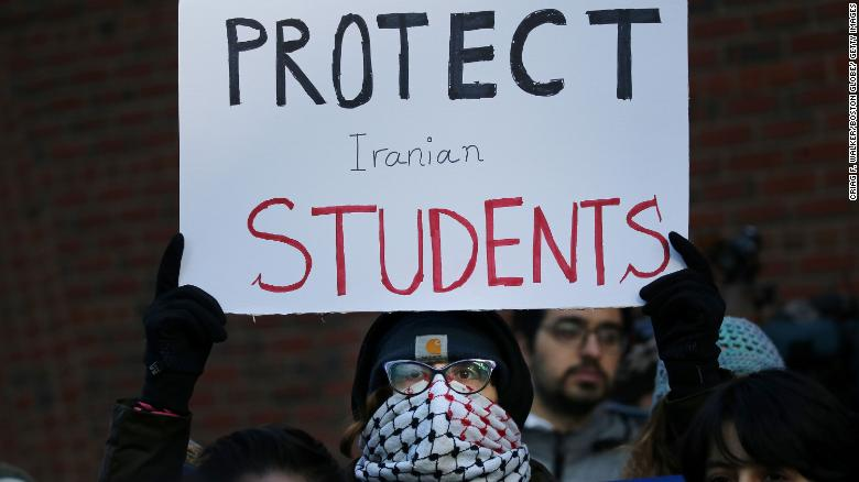 Cassidy Taylor offers support to a deported Iranian student while protesting outside the federal courthouse in Boston on January 21.