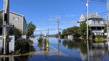 Post-storm flood water inundate a street in Seaside Park, New Jersey.