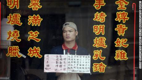 An employee of an empty Chinatown restaurant in Chicago on April 24, 2003, as fears over the SARS epidemic kept customers away.