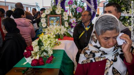 People mourn next to the coffin with the remains of Mexican environmentalist Homero Gomez, during his funeral in El Rosario village.