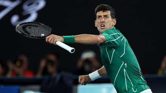 Novak Djokovic celebrates winning the second set against Roger Federer on his way to reaching an eighth Australian Open final on January 30.