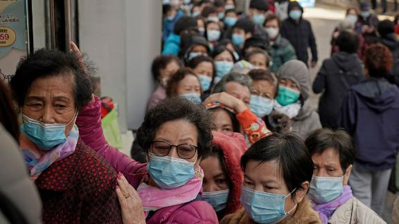 """People queue up to buy face masks at a cosmetics shop in Hong Kong, Thursday, Jan. 30, 2020. Hong Kong cut off rail service to mainland China at midnight on Wednesday to Thursday to try to stop the spread of a new virus to the city. The death toll rose to 170 in the new virus outbreak in China on Thursday as foreign evacuees from the worst-hit region begin returning home under close observation and world health officials expressed """"great concern"""" that the disease is starting to spread between people outside of China. (AP Photo/Kin Cheung)"""