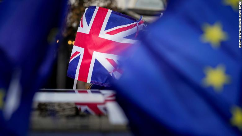 A picture taken on January 30, 2020 shows a Union Jack during a protest against Brexit near the European Parliament in Brussels. - Britain's departure from the European Union was set in law on January 29, amid emotional scenes, as the bloc's parliament voted to ratify the divorce papers. After half a century of sometimes awkward membership and three years of tense withdrawal talks, the UK will leave the EU at midnight Brussels time (2300 GMT) on January 31, 2020. (Photo by Kenzo TRIBOUILLARD / AFP) (Photo by KENZO TRIBOUILLARD/AFP via Getty Images)
