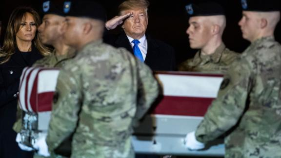 Trump and the first lady watch as a US Army carry team moves a transfer case containing the remains of Chief Warrant Officer 2 David C. Knadle in November 2019. Knadle, 33, was killed in a helicopter crash while serving in Afghanistan.