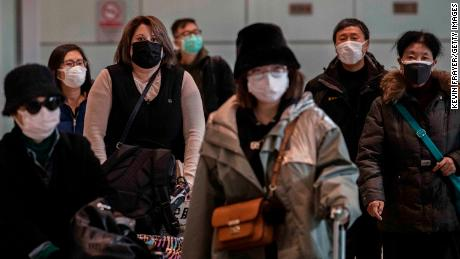 BEIJING, CHINA - JANUARY 30: Passengers wear protective masks as they arrive at Beijing Capital Airport on January 30, 2020 in Beijing, China. The number of cases of a deadly new coronavirus rose to over 7000 in mainland China Thursday as the country continued to lock down the city of Wuhan in an effort to contain the spread of the pneumonia-like disease which medicals experts have confirmed can be passed from human to human. In an unprecedented move, Chinese authorities put travel restrictions on the city which is the epicentre of the virus and neighbouring municipalities affecting tens of millions of people. The number of those who have died from the virus in China climbed to over 170 on Thursday, mostly in Hubei province, and cases have been reported in other countries including the United States, Canada, Australia, Japan, South Korea, and France. The World Health Organization  has warned all governments to be on alert, and its emergency committee is to meet later on Thursday to decide whether to declare a global health emergency. (Photo by Kevin Frayer/Getty Images)