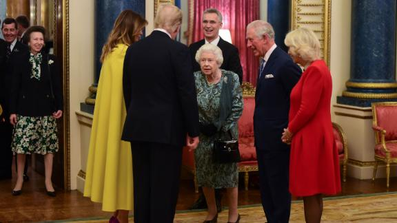 The Trumps greet Britain's Queen Elizabeth II during a NATO reception held at Buckingham Palace in December 2019.