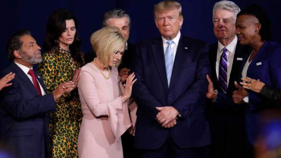 Faith leaders pray with Trump in Miami during a rally for evangelical supporters in January 2020.