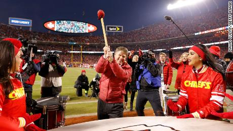 Kansas City Chiefs owner Clark Hunt bangs the drum before a game. Drums are important parts of Native culture.