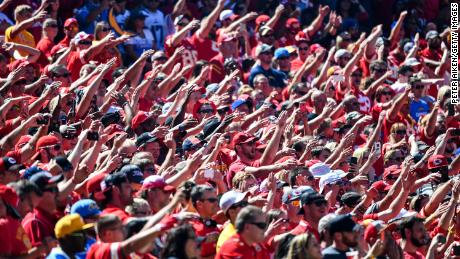 Kansas City Chiefs fans do the tomahawk chop before a game against the San Diego Chargers.