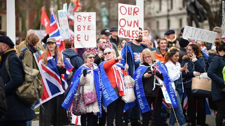 Pro-Brexit supporters wave placards at Parliament Square as people prepare for Brexit on January 31.