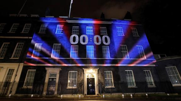 A digital Brexit countdown clock shows 00:00 as the time reaches 11 o'clock, as it is projected onto the front of 10 Downing Street, the official residence of Britain's Prime Minister, in central London on January 31, 2020, as Britain prepares to leave the European Union at 2300GMT. - Brexit supporters gathered outside parliament on Friday to cheer Britain's departure from the European Union following three years of epic political drama -- but for others there were only tears. After 47 years in the European fold, the country leaves the EU at 11:00pm (2300 GMT) on Friday, with a handful of the most enthusiastic supporters gathering opposite the Houses of Parliament 12 hours before the final countdown. (Photo by Tolga AKMEN / AFP) (Photo by TOLGA AKMEN/AFP via Getty Images)