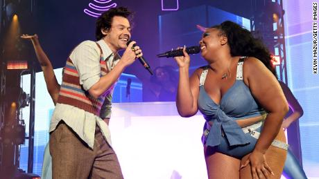 Harry Styles appeared at Lizzo's concert in Miami Beach on Thursday, but his own concert was called off because of weather a night later.