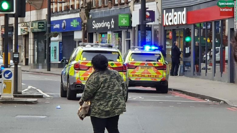 Image from the scene where a man has been shot by armed officers in Streatham. Due to the graphic nature of the scene, CNN has blurred the body of the suspect.