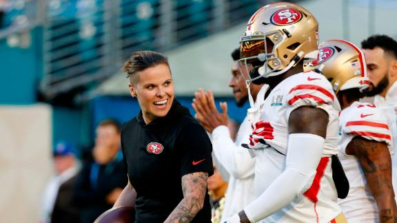 San Francisco 49ers assistant coach Katie Sowers talks with players before the start of the game. She is the first woman and openly gay person to coach in a Super Bowl.