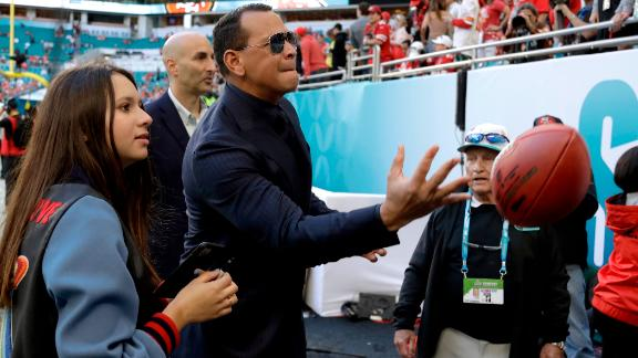 Former baseball star Alex Rodriguez tosses a football before the game. His girlfriend, Jennifer Lopez, performed during the halftime show.