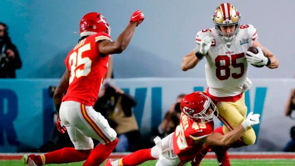 San Francisco tight end George Kittle is tackled by Daniel Sorensen in the first quarter.