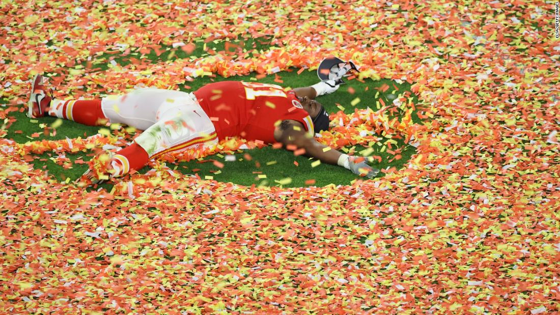 Kansas City's Derrick Nnadi makes a confetti angel after the game.