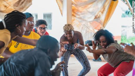 Scholars dancing with a professor from the University of Ghana's Performing Arts School in Accra, Ghana in 2018.