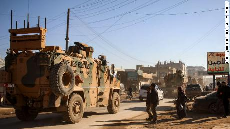 A Turkish military convoy of passes through the Syrian town of Dana on February 2.
